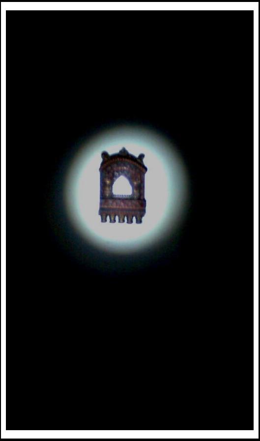 Rajasthani Jharokha artwork on the wall, illuminated by my LED torchlight